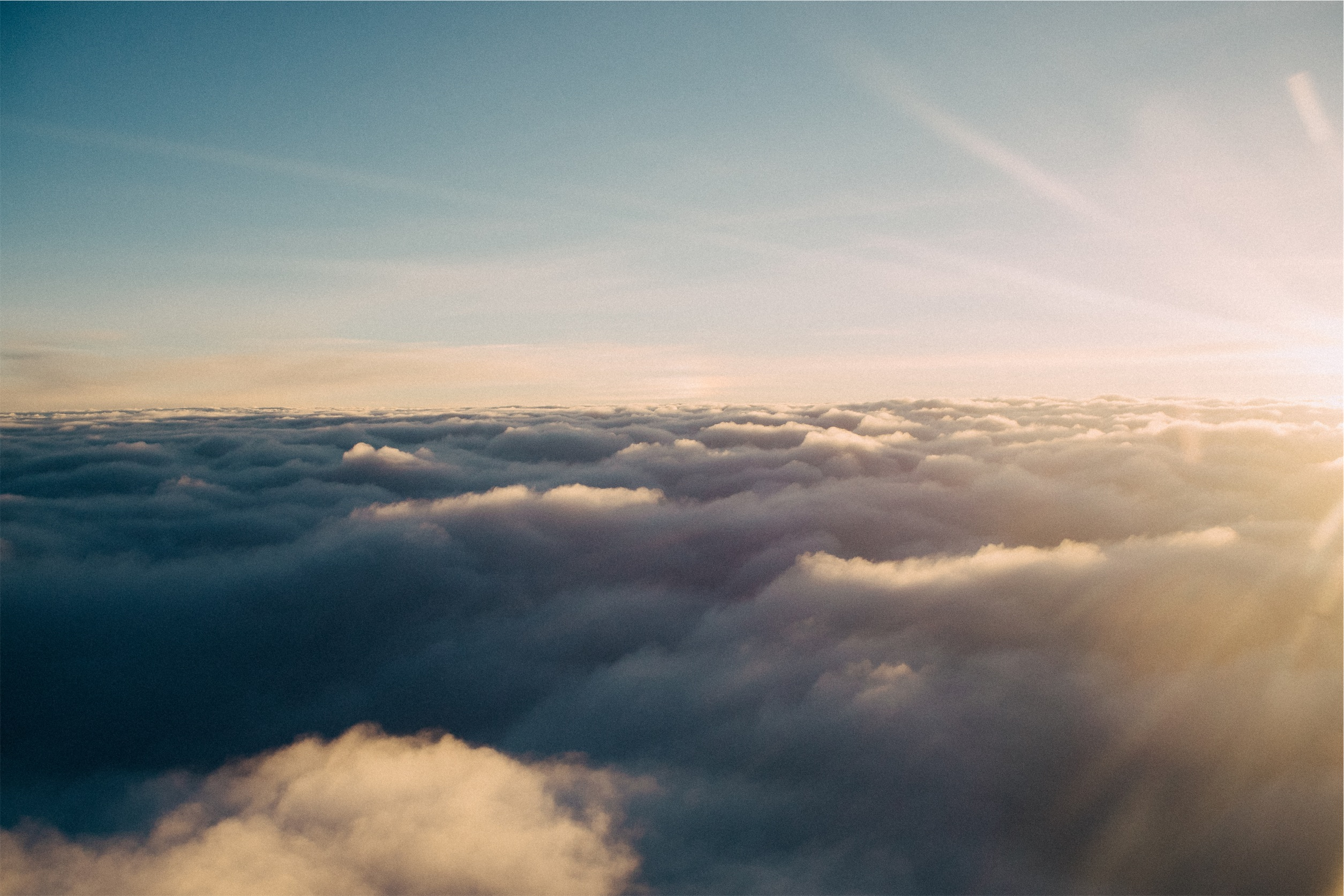 above the clouds shot with the sun shining through